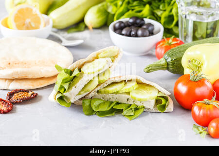 Healthy sandwiches with vegetables and tofu in pita. Love for a healthy vegan food concept. - Stock Photo