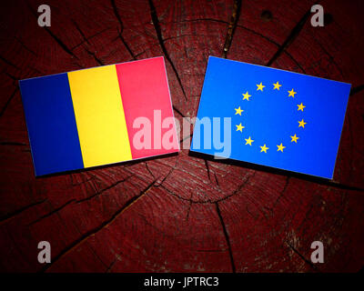 Chad flag with EU flag on a tree stump isolated - Stock Photo