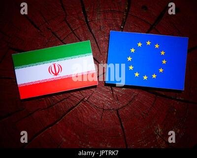 Iranian flag with EU flag on a tree stump isolated - Stock Photo