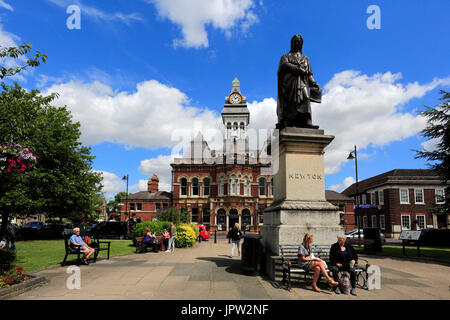 Statue of Sir Issac Newton and the Guildhall, Town hall of Grantham, Lincolnshire, England, UK - Stock Photo