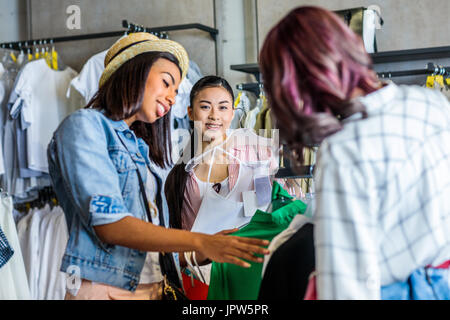 multicultural hipster young girls shopping in boutique, fashion shopping girls concept     - Stock Photo