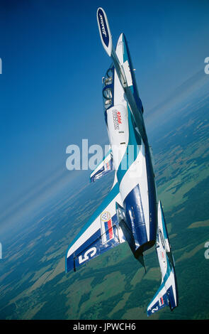 Russian AirForce Team Rus Aero Vodochody L-39 Albatross formation in a vertical climb over green fields and forests
