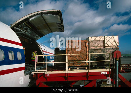 cargo being loaded onto a McDonnell Douglas DC-10-30CF - Stock Photo