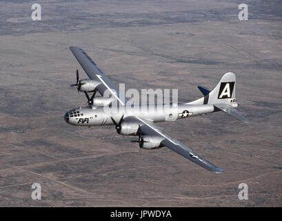 USAF Boeing B-29 Super Fortress named 'FiFi' flying over a desert landscape at the 1997 Confederate-Air-Force Airshow - Stock Photo