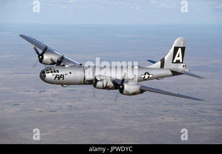 USAF Boeing B-29 Super Fortress named 'FiFi' flying over a desert landscape - Stock Photo