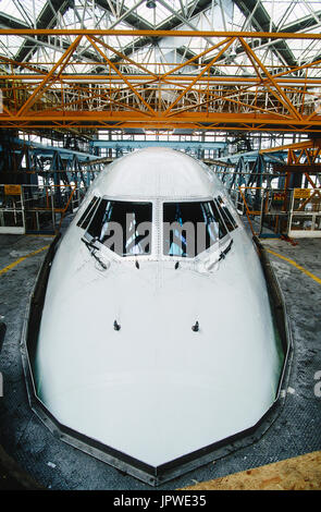 British Airways Boeing 747-400 nose and windshield in a maintenance bay inside a TBK hangar - Stock Photo