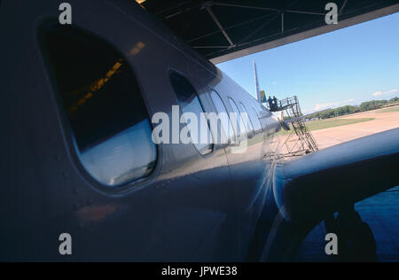 maintenance in a hangar with engineers inspecting the tail of a LAPA Boeing 757-200 - Stock Photo
