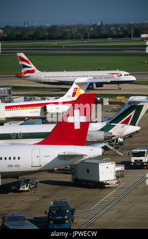 an international mix of tail-fins of Swiss International Airlines Airbus A321-200, Alitalia and Iberia McDonnell - Stock Photo