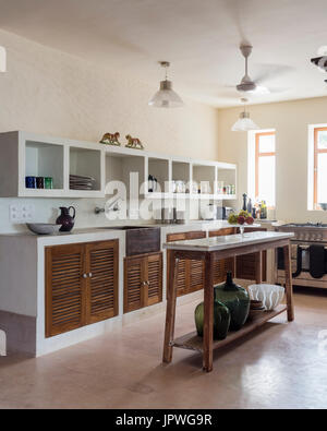 White kitchen with wooden cupboards - Stock Photo