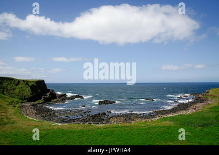 Scenic Portnaboe sits just below the Giant's Causeway Visitor's Centre and its home to famous Finn McCool's camel - Stock Photo
