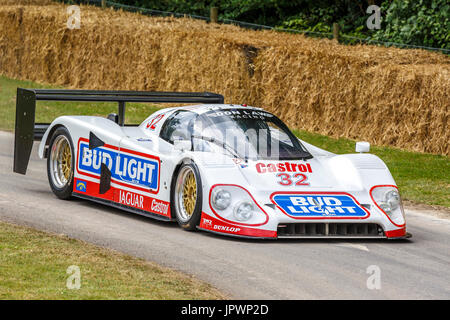 1993 Jaguar XJR-12D Group C endurance racer with driver Justin Law at the 2017 Goodwood Festival of Speed, Sussex, - Stock Photo