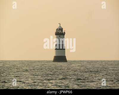 Trwyn Du Penmon Lighthouse in Menai Strait between Dinmor Point near Penmon and Ynys Seriol Puffin Island  eastern - Stock Photo