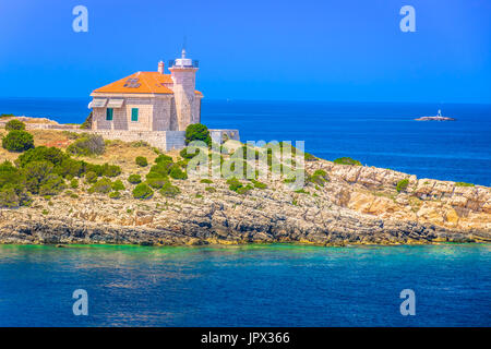 Seafront view at lighthouse in Croatia, island Vis Mediterranean. - Stock Photo