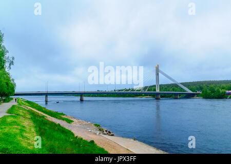 View of the Lumberjacks Candle Bridge and the Kemijoki River in Rovaniemi, Lapland, Finland - Stock Photo