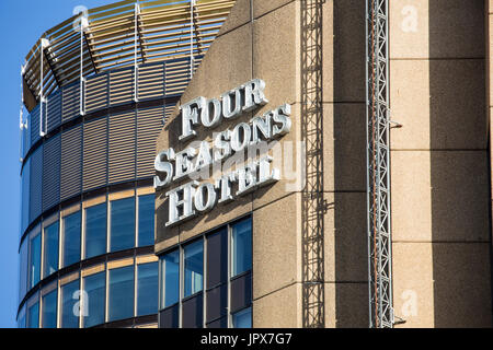Four seasons hotel and signage in Sydney city centre,new south wales,australia - Stock Photo