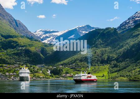 Cruise ships ocean liner and Hurtigruten cruise ship Polarlys in anchored offshore in summer. Geirangerfjorden or - Stock Photo