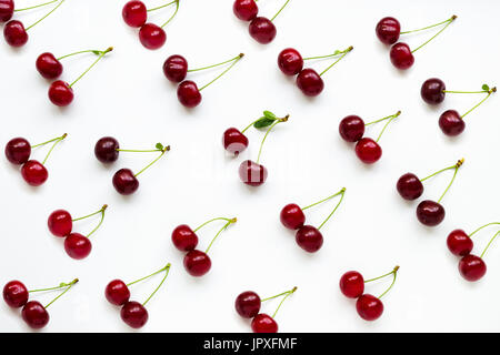 Cherries with petioles lined in rows on a white background. Pattern of cherries. Fruit Pattern - Stock Photo