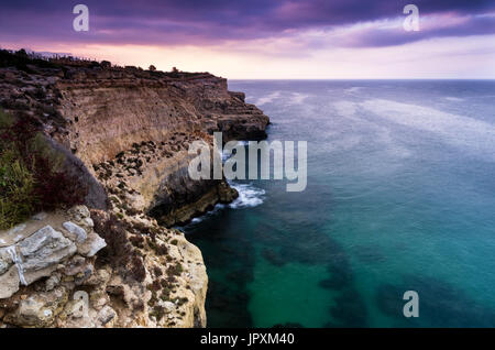 High rocky coastline with nice view in the Algarve, Portugal - Stock Photo