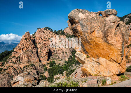 Orange porphyritic granite rocks, at Les Calanche de Piana, UNESCO World Heritage Site, Corse-du-Sud, Corsica, France - Stock Photo