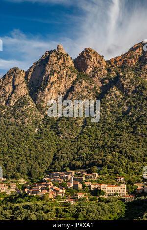Capo d'Ota massif over hill town of Ota, Gorges de Spelunca, Corse-du-Sud, Corsica, France - Stock Photo