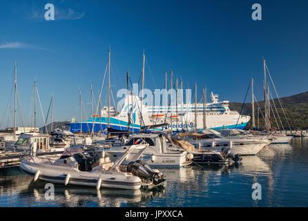 Sailboats at marina, M/F Kalliste ferry at pier behind, at Golfe de Valinco, Propriano, Corse-du-Sud, Corsica, France - Stock Photo