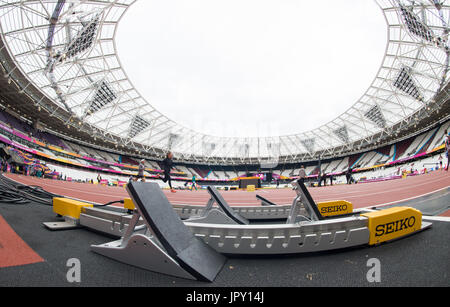 London, UK. 2nd Aug, 2017. Starting blocks stand at the ready in the interior of the Olympic Stadium in London, - Stock Photo