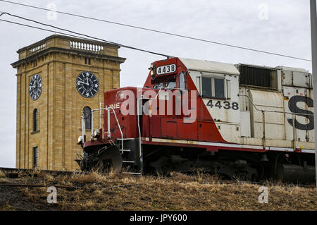 Rock Island, Iowa, USA. 19th Jan, 2017. A train passes by the Rock Island Arsenal Clock Tower Building on Thursday, - Stock Photo