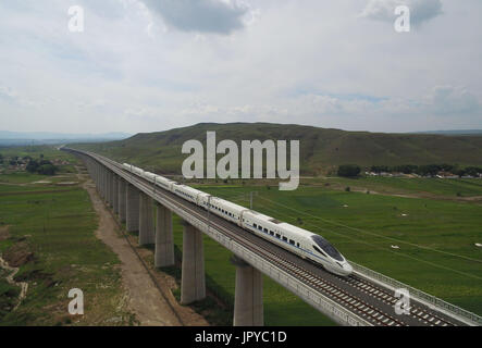 Hohhot. 3rd Aug, 2017. A train runs on the Hohhot section of Zhangjiakou-Hohhot high speed railway in north China's - Stock Photo