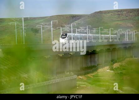 Hohhot. 3rd Aug, 2017. A train runs on the Ulanqab section of Zhangjiakou-Hohhot high speed railway in north China's - Stock Photo
