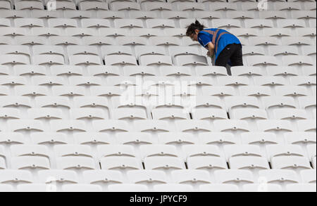 London, UK. 03rd Aug, 2017. London, 03 August 2017. A stadium worker cleans one of 60,000 seats ahead of the IAAF - Stock Photo
