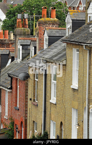 a typical row of terraced houses or homes on a hill at different levels - Stock Photo