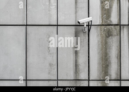 security camera - cctv on building wall - Stock Photo