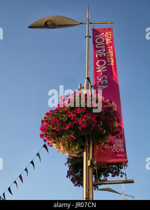 Banner flag and Flower Basket along High Street, Southend-on-Sea, Essex, UK - Stock Photo