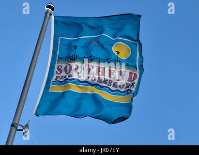 SOUTHEND-ON-SEA, ESSEX, UK:  Flag banner advertising Southend Pier and Foreshore blowing in the wind - Stock Photo