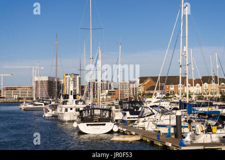 View over the marina in Ocean Village with the new development of flats in Centenary Quay in the background in Southampton - Stock Photo