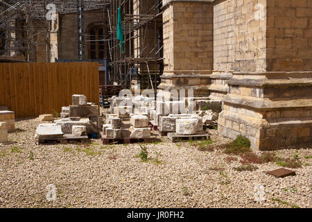 stone masons yard in york with scaffolding and york stone being carved in summer - Stock Photo