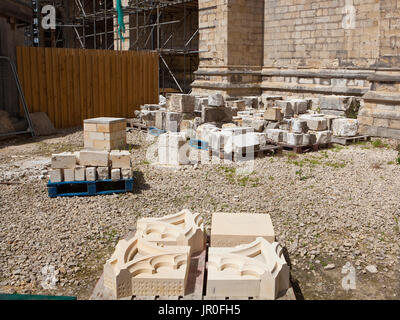 Newly carved stone for the restoration of York Minster in a stone masons yard - Stock Photo