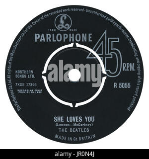 45 RPM 7' UK record label of She Loves You by The Beatles on the Parlophone label from 1963. - Stock Photo