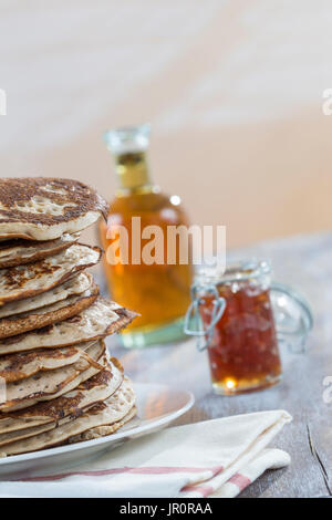 Glutten-free pancakes with jam and Maple syrup, bio healthy ingredients, on white - Stock Photo
