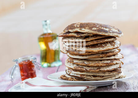 Glutten-free pancakes with jam and Maple syrup, ingredients, background - Stock Photo