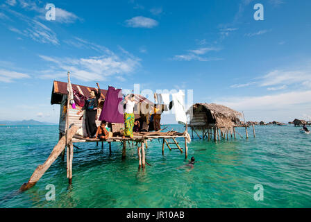 Semporna, Malaysia - 17 September, 2011: Bajau laut in their floating village of stilted houses off the coast of - Stock Photo