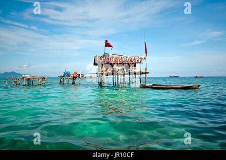 Semporna, Malaysia - 17 September, 2011: A Bajau laut floating village of stilted houses off the coast of Borneo - Stock Photo