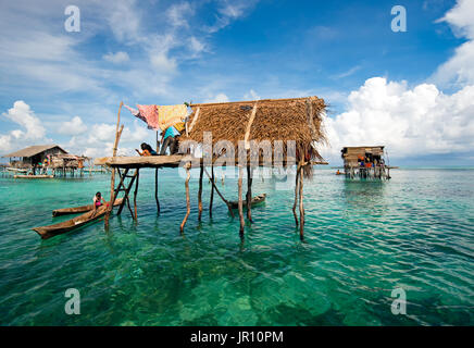 Semporna, Malaysia - 19 April, 2015: A Bajau laut floating village of stilted houses off the coast of Borneo in - Stock Photo