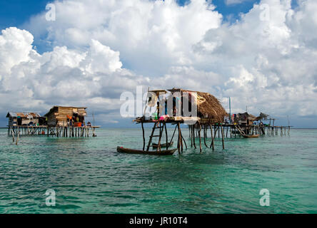 Semporna, Malaysia - 19 April, 2015: A Bajau floating village of stilted houses off the coast of Borneo in The Celebes - Stock Photo