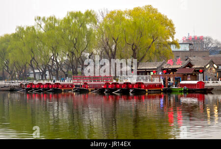 Dinner boats await customers, Shichahai (Houhai) District at Twilight, Beijing, China. - Stock Photo