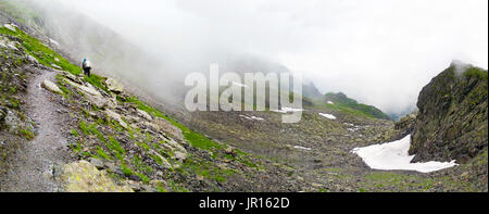 Hikers going to Negoiu peak part of Fagaras Mountain range, Romania - Stock Photo