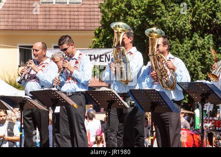 Buchlovice, Czech Republic, July 29, 2017: Traditional brass band at folk festivals. Traditional farmers harvest - Stock Photo