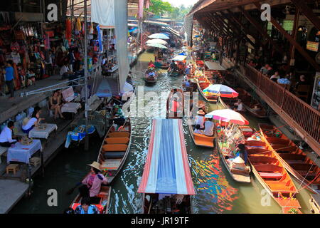 Floating market of Damnoen Saduak, one of the main tourist attractions in the vicinity of Bangkok, Thailand - Stock Photo