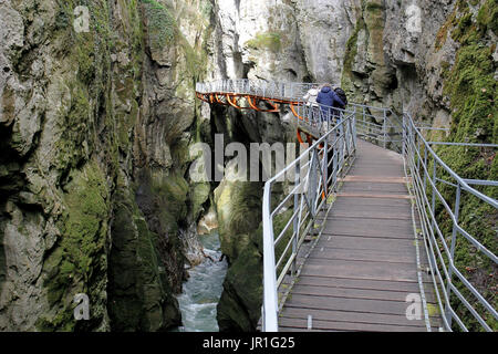 Group of people strolling in Fier Gorges, a rearranged natural site in Lovagny, Alpes, France - Stock Photo