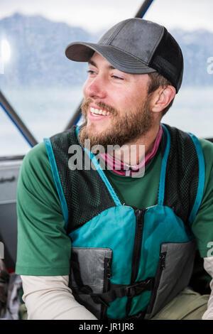 Tourist On Boat Wearing A Life Vest, Seward, Southcentral Alaska, USA - Stock Photo
